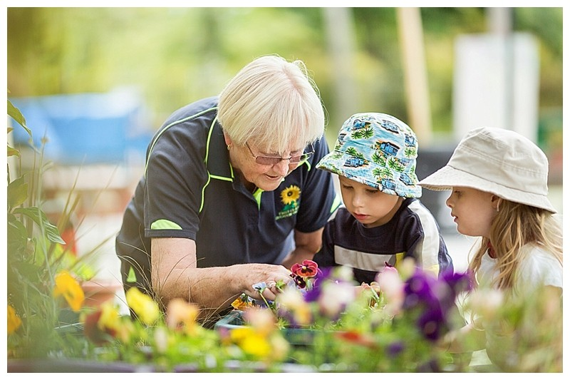 First Class Education and Care_Childcare Tauranga_Children Gardening with Teacher
